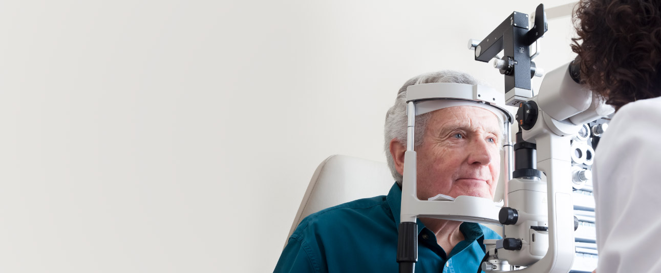 Mature man getting an eye exam.
